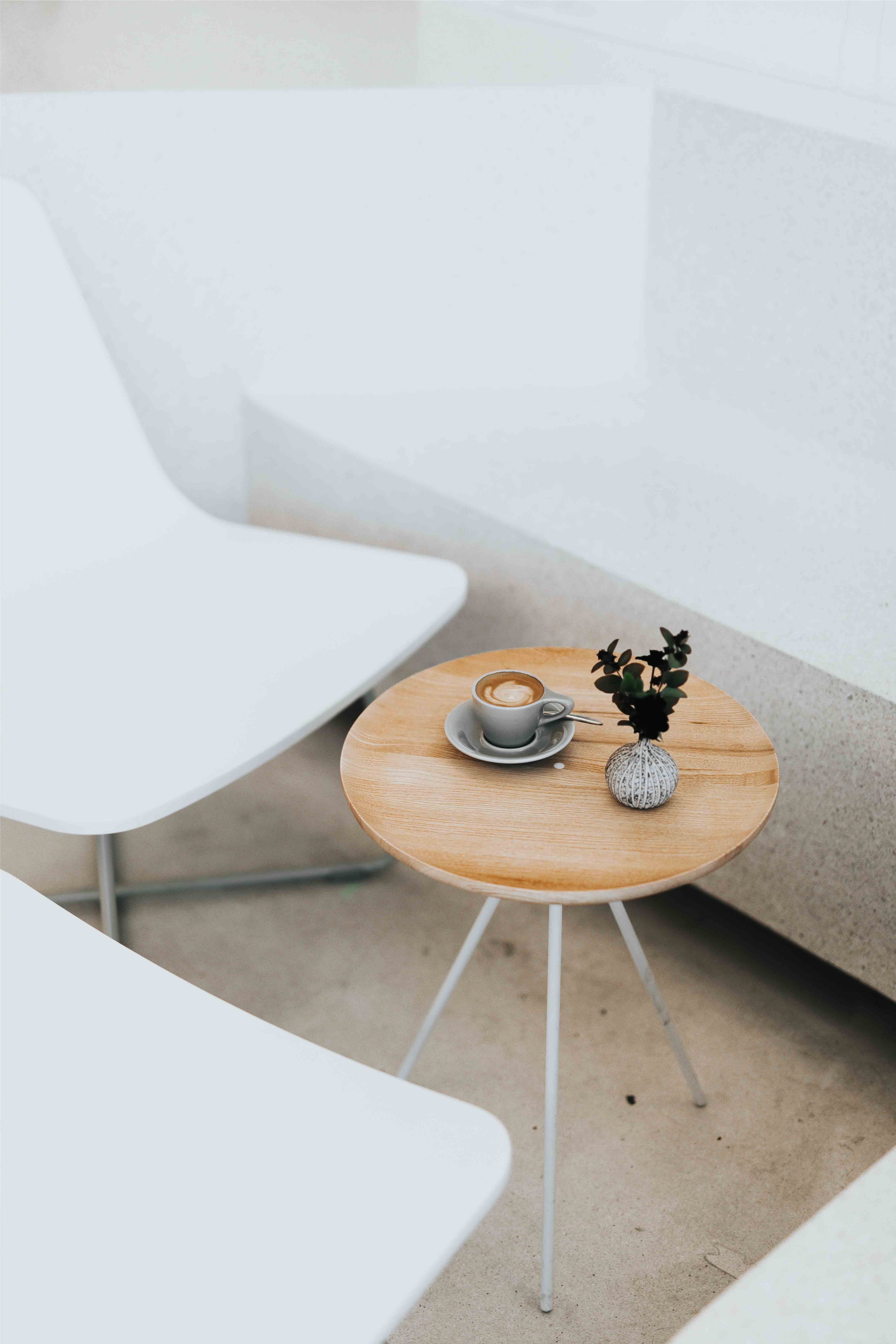 Wooden Table and White Chairs with Coffee